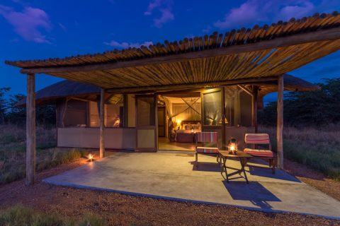 Camp Hwange guest chalet after dark, Hwange NP